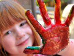Stephanie Roberts, MA, OTR/L, girl's paint-covered hand