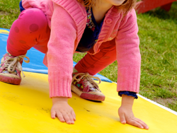 Stephanie Roberts, MA, OTR/L, girl on play mat