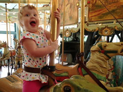 Stephanie Roberts, MA, OTR/L, girl on merry-go-around